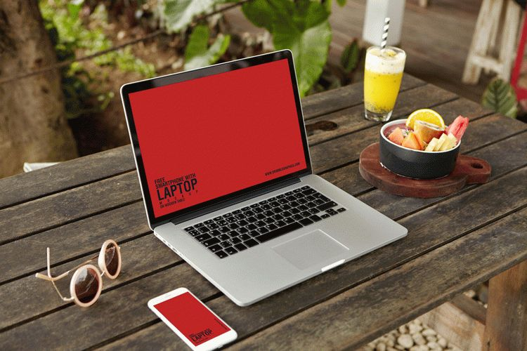 Free Smartphone With Laptop Mockup on Wooden Table
