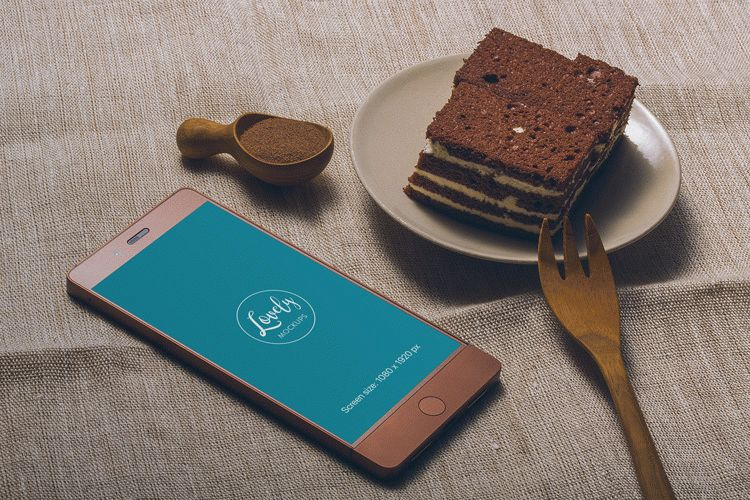 Smartphone and a tasty Cake on a Table